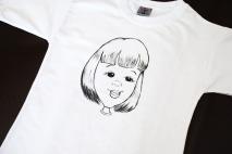 Caricaturas em camisetas feitas ao vivo e à mão.